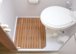 Teak floor in custom class B bathroom